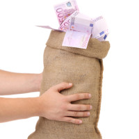 Man hands holding money bag full with euro banknotes